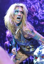 """FILE - Singer Ke$ha performs at the Casio Shock the World 2010 event in New York on Aug. 2, 2010. Kesha's song, """"TiK ToK,"""" the drunken party anthem and multi-platinum debut single, a song that dominated the year in music, didn't garner a nomination at the Grammys. (AP Photo/Louis Lanzano, File)"""