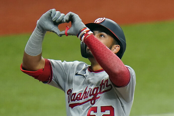Washington Nationals' Luis Garcia (62) celebrates his two-run home run off Tampa Bay Rays relief pitcher Nick Anderson during the 10th inning of a baseball game Wednesday, Sept. 16, 2020, in St. Petersburg, Fla. (AP Photo/Chris O'Meara)