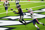 Houston Texans wide receiver Keke Coutee (16) catches a pass for a touchdown in front of New England Patriots defensive back Jonathan Jones (31) during the first half of an NFL football game, Sunday, Nov. 22, 2020, in Houston. (AP Photo/David J. Phillip)