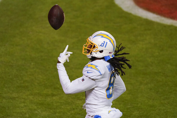 Los Angeles Chargers wide receiver Mike Williams celebrates after catching a 48-yard touchdown pass during the second half of an NFL football game against the Kansas City Chiefs, Sunday, Jan. 3, 2021, in Kansas City. (AP Photo/Charlie Riedel)