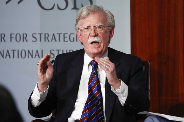 FILE - In this Sept. 30, 2019, file photo, former National security adviser John Bolton gestures while speakings at the Center for Strategic and International Studies in Washington.   A federal judge has ruled, Saturday, June 20, 2020, that former national security adviser John Bolton can move forward in publishing his tell-all book. The Trump administration had tried to block the release because of concerns that classified information could be exposed.(AP Photo/Pablo Martinez Monsivais, File)