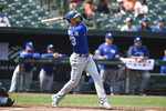 Toronto Blue Jays' Lourdes Gurriel Jr. follows through on a grand slam against the Baltimore Orioles in the first inning of a baseball game Sunday, Sept. 12, 2021, in Baltimore. (AP Photo/Gail Burton)