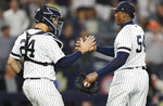 New York Yankees catcher Gary Sanchez (24) congratulates relief pitcher Aroldis Chapman after the Yankees defeated the Houston Astros 4-1 in a baseball game Friday, June 21, 2019, in New York. (AP Photo/Kathy Willens)