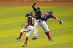 Boston Red Sox left fielder Yairo Munoz, left, center fielder Jackie Bradley Jr., center, and right fielder Alex Verdugo, right, celebrate after a baseball game against the Miami Marlins, Tuesday, Sept.15, 2020, in Miami.  (AP Photo/Lynne Sladky)