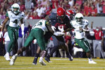 North Carolina State running back Ricky Person Jr. (8) runs for a touchdown while South Florida defensive back Mekhi LaPointe (22) tries to make the tackle during the first half of an NCAA college football game in Raleigh, N.C., Thursday, Sept. 2, 2021. (AP Photo/Gerry Broome)