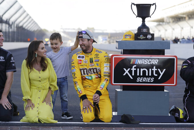 NASCAR Xfinity Series driver Kyle Busch celebrates with his wife, Samantha, and son, Brexton, after winning the NASCAR Xfinity auto race at the Indianapolis Motor Speedway, Saturday, Sept. 7, 2019 in Indianapolis. (AP Photo/Darron Cummings)