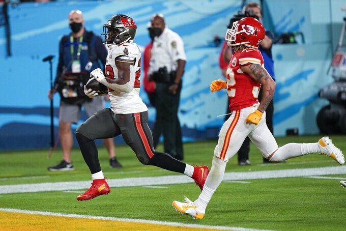 Tampa Bay Buccaneers running back Leonard Fournette runs for a touch down against the Kansas City Chiefs during the second half of the NFL Super Bowl 55 football game Sunday, Feb. 7, 2021, in Tampa, Fla. (AP Photo/David J. Phillip)