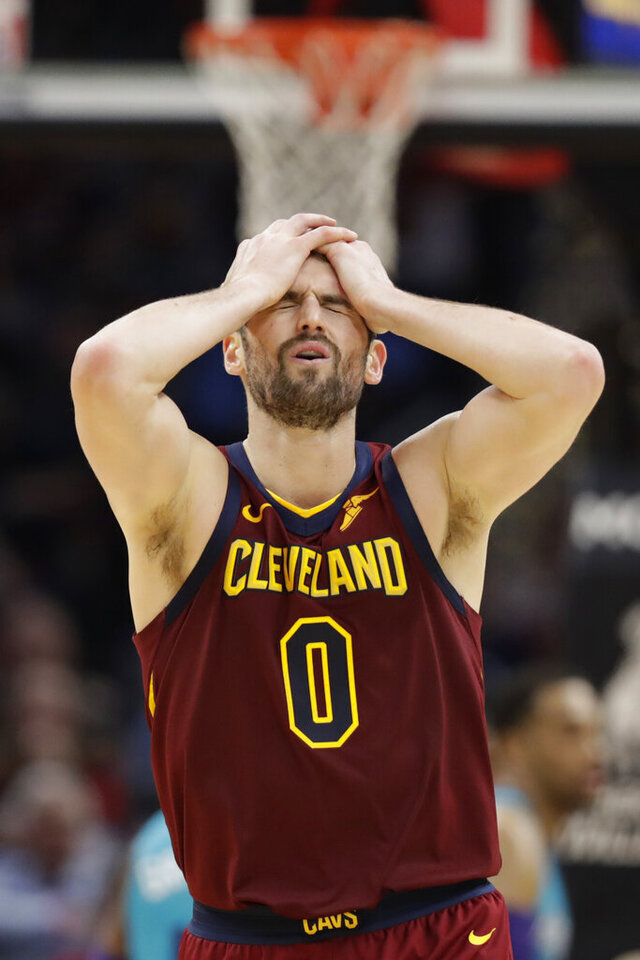 Cleveland Cavaliers' Kevin Love reacts after missing a three-point basket late in the second half of an NBA basketball game against the Charlotte Hornets, Thursday, Jan. 2, 2020, in Cleveland. (AP Photo/Tony Dejak)