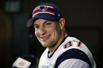 FILE - In this Jan. 30, 2019 file photo New England Patriots' Rob Gronkowski speaks with members of the media during a news conference ahead of the NFL Super Bowl 53 football game against Los Angeles Rams in Atlanta. As teams settle in at sweltering training camps this week, playbooks are distributed (digitally, of course), rookies and other youngsters try to catch the eye of decision makers, and fans wonder what their teams will look like in early September. And beyond. Except, perhaps, in New England. We're not likely to see much of Patriots quarterback Tom Brady until opening day. We won't see any of his buddy and standout tight end, Rob Gronkowski, whose battered body caused him to retire. (AP Photo/Matt Rourke, file)