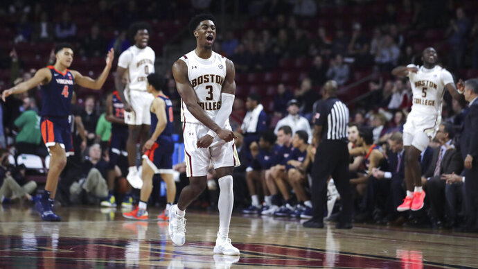 Boston College guard Jared Hamilton (3) celebrates after winning a turnover against Virginia during late in the second half of an NCAA college basketball game Tuesday, Jan. 7, 2020 in Boston. Boston College upset Virginia 60-53. (AP Photo/Charles Krupa)