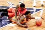 Pittsburgh's Xavier Johnson, right, and Syracuse's Frank Howard (23) go after the ball during the first half of an NCAA college basketball game, Saturday, Feb. 2, 2019, in Pittsburgh. (AP Photo/Keith Srakocic)