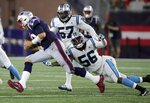 New England Patriots quarterback Tom Brady runs with the ball as Carolina Panthers linebacker Jermaine Carter (56) chases him in the first half of an NFL preseason football game, Thursday, Aug. 22, 2019, in Foxborough, Mass. (AP Photo/Charles Krupa)