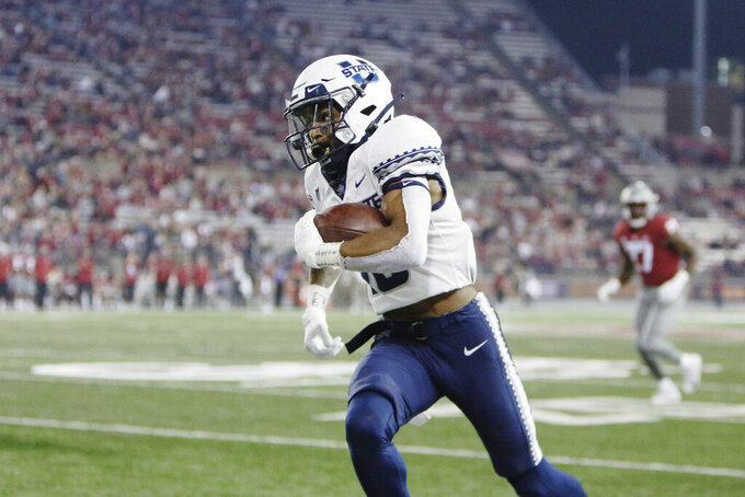 Utah State wide receiver Deven Thompkins carries the ball during the second half of an NCAA college football game against Washington State, Saturday, Sept. 4, 2021, in Pullman, Wash. Utah State won 26-23. (AP Photo/Young Kwak)