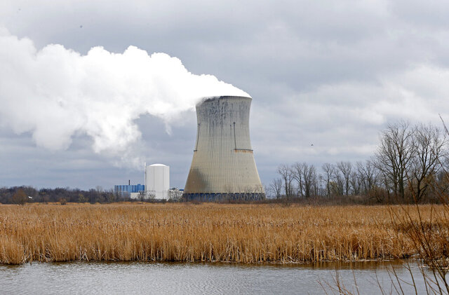 FILE – In this April 4, 2017, file photo, is the then-FirstEnergy Corp.'s Davis-Besse Nuclear Power Station in Oak Harbor, Ohio. The committee designated to determine the fate of the legislation that aimed to bailout Ohio's two nuclear plants adjourned Wednesday, Sept. 30, 2020, on the eve of the deadline to replace it before a fee is added to nearly every electricity bill in the state starting Jan 1, 2021. (AP Photo/Ron Schwane, File)