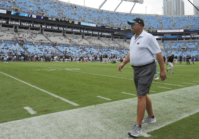 FILE - In this Oct. 7, 2018, file photo, Carolina Panthers owner David Tepper walks the field before the NFL football team's game against the New York Giants in Charlotte, N.C. Tepper expressed frustration with government officials over not allowing fans in the stadium for the team's Sept. 13 home opener against the Las Vegas Raiders. Tepper said he'll continue to have conversations with government officials, including North Carolina Gov. Roy Cooper, about allowing the team to bring in a limited number of fans into Bank of America Stadium for future home games this season. (AP Photo/Mike McCarn, File)