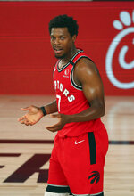 Toronto Raptors guard Kyle Lowry (7) reacts during the first half of an NBA basketball game against the Orlando Magic  Wednesday, Aug. 5, 2020, in Lake Buena Vista, Fla. (Kim Klement/Pool Photo via AP)
