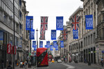 Union flags and support messages are seen in the shopping street, Oxford Street, ahead of the reopening of the non-essential businesses on Monday, June 15, as some of the coronavirus lockdown measures are eased, in London, Friday, June 12, 2020. The British economy shrank by a colossal 20.4% in April, the first full month that the country was in its coronavirus lockdown, official figures showed Friday. (AP Photo/Alberto Pezzali)