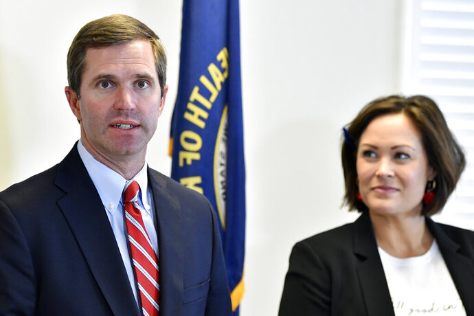 FILE - In this Nov. 14, 2019, file photo, Kentucky Gov.-elect Andy Beshear, left, and Lt. Gov.-elect Jacqueline Coleman speak with reporters following the concession of incumbent Gov. Matt Bevin in Frankfort, Ky. It's a role that seems scripted for Coleman, as an educator transitioning to the job as a