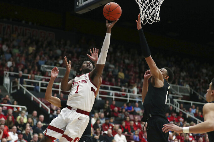 Stanford guard Daejon Davis (1) shoots against Colorado guard Tyler Bey (1) during the first half of an NCAA college basketball game in Stanford, Calif., Sunday, March 1, 2020. (AP Photo/Jed Jacobsohn)