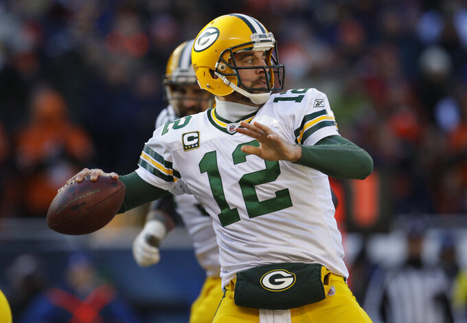 FILE - In this Jan. 23, 2011, file photo, Green Bay Packers quarterback Aaron Rodgers (12) throws a pass during the first half of the NFC Championship NFL football game against Chicago Bears in Chicago. In their long  rivalry, the Packers and the Bears have played 198 times. Only two meetings came in the playoffs. In Jan. 2011, they faced off for the NFC title and a trip to the Super Bowl. Rodgers and a staunch defense silenced Soldier Field, building a 14-0 lead and 21-7 lead and won their third successive road game in the postseason. (AP Photo/Nam Y. Huh, File)