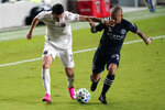 Inter Miami midfielder Lewis Morgan (7) and New York City FC midfielder Alexandru Mitrita (28) go for the ball during the first half of an MLS soccer match, Saturday, Oct. 3, 2020, in Fort Lauderdale, Fla. (AP Photo/Lynne Sladky)