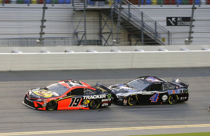 Martin Truex Jr. (19) and Kevin Harvick (4) race on the front stretch during the NASCAR Cup Series auto race at Daytona International Speedway, Saturday, Aug. 29, 2020, in Daytona Beach, Fla. (AP Photo/Terry Renna)