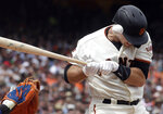 San Francisco Giants' Buster Posey is hit by a throw from New York Mets pitcher Seth Lugo during the eighth inning of a baseball game in San Francisco, Sunday, July 21, 2019. (AP Photo/Jeff Chiu)