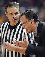 Georgia head coach Tom Crean pleads his case to a referee after his player was called for a technical foul in the first half of an NCAA college basketball game against LSU, Wednesday, Jan. 23, 2019, in Baton Rouge, La. (AP Photo/Bill Feig)