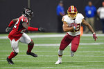 Washington Redskins running back Derrius Guice (29) runs against the Atlanta Falcons during the first half an NFL preseason football game, Thursday, Aug. 22, 2019, in Atlanta. (AP Photo/Mike Stewart)
