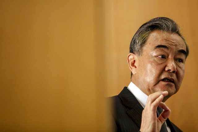 FILE - In this Aug. 30, 2020 file photo, Chinese Foreign Minister Wang Yi delivers a speech during a press conference at the Institute for International Relations in Paris. China on Tuesday, Sept. 8, 2020 unveiled its own initiative to address global data security issues, a countermove that comes a month after the U.S. announced its
