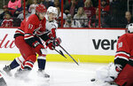 Washington Capitals' Dmitry Orlov, of Russia, shoots against Carolina Hurricanes goalie Cam Ward as Hurricanes' Trevor van Riemsdyk (57) defends during the first period of an NHL hockey game in Raleigh, N.C., Friday, Jan. 12, 2018. (AP Photo/Gerry Broome)