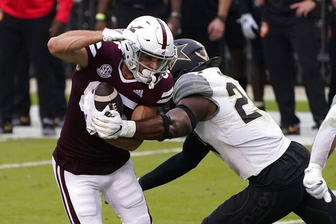 Mississippi State wide receiver Austin Williams (85) catches a pass in front of Vanderbilt linebacker Alston Orji (24) during the second half of an NCAA college football game in Starkville, Miss., Saturday, Nov. 7, 2020. (AP Photo/Rogelio V. Solis)