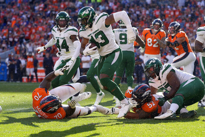 New York Jets linebacker Del'Shawn Phillips (43) runs a fumble recovery against the Denver Broncos during the second half of an NFL football game, Sunday, Sept. 26, 2021, in Denver. The Broncos won 26-0. (AP Photo/David Zalubowski)