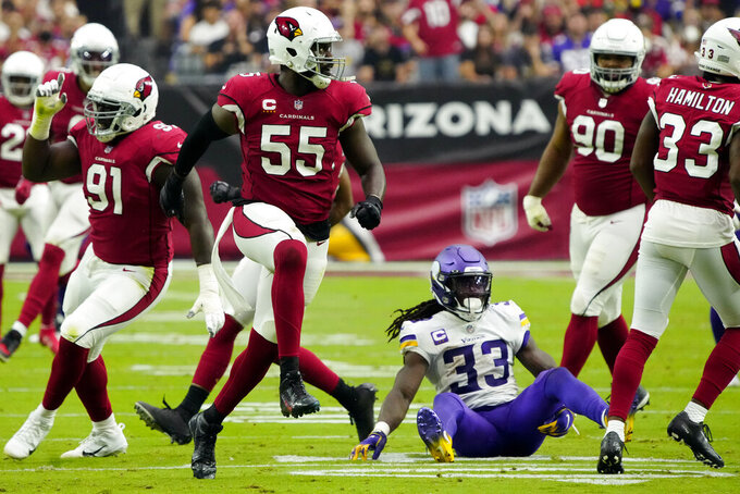 Arizona Cardinals linebacker Chandler Jones (55) celebrates his hit on Minnesota Vikings running back Dalvin Cook (33) during the second half of an NFL football game, Sunday, Sept. 19, 2021, in Glendale, Ariz. (AP Photo/Rick Scuteri)