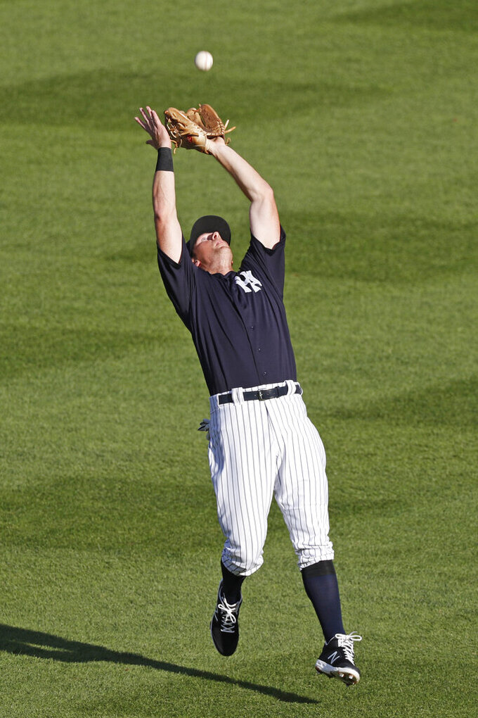 New York Yankees second baseman D.J. LeMahieu fields a pop fly over his head during the first inning of an exhibition baseball gam against the Philadelphia Phillies, Monday, July 20, 2020, at Yankee Stadium in New York. (AP Photo/Kathy Willens)