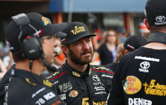 FILE - In this Aug. 10, 2018, file photo, Martin Truex Jr. watches times during qualifications for a NASCAR Cup Series auto race at Michigan International Speedway in Brooklyn, Mich. Truex begins his quest to repeat as NASCAR's champion at the playoff opener this weekend in Vegas. (AP Photo/Paul Sancya)