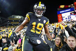 Pittsburgh Steelers wide receiver JuJu Smith-Schuster (19) climbs down from the stands after celebrating his touchdown with fans during the second half of an NFL football game against the Miami Dolphins in Pittsburgh, Monday, Oct. 28, 2019. (AP Photo/Don Wright)