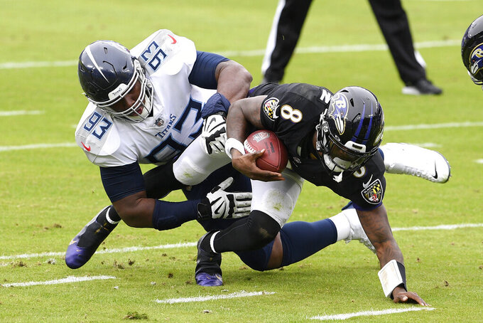 Baltimore Ravens quarterback Lamar Jackson (8) is sacked by Tennessee Titans defensive tackle Teair Tart (93) during the first half of an NFL football game, Sunday, Nov. 22, 2020, in Baltimore. (AP Photo/Nick Wass)