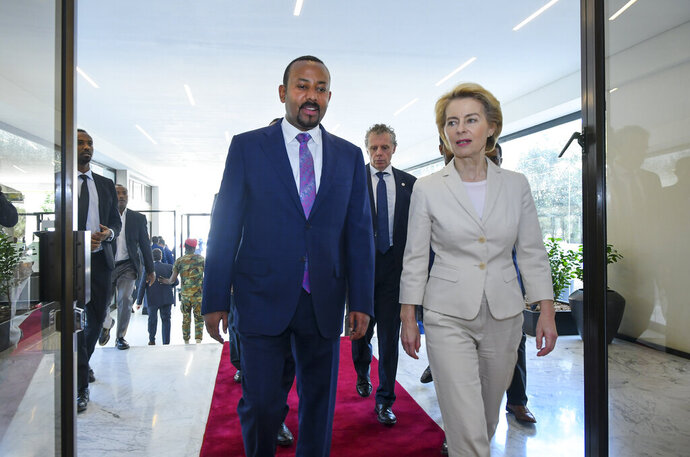 Newly elected President of the European Commission Ursula von der Leyen, right, walks with Ethiopia's Nobel Peace Prize winning Prime Minister, Abiy Ahmed, left, as they meet at the Prime Minister's office in the capital Addis Ababa, Ethiopia Saturday, Dec. 7, 2019. The new European Commission president says she chose Africa as her first visit outside Europe as it has some of the world's fastest-growing economies and some of its biggest challenges including climate change. (AP Photo)