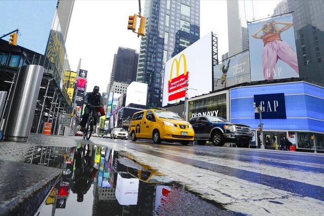 Cars and cyclists move through Times Square after a rain shower during the coronavirus pandemic, Saturday, May 23, 2020, in New York. (AP Photo/Frank Franklin II)