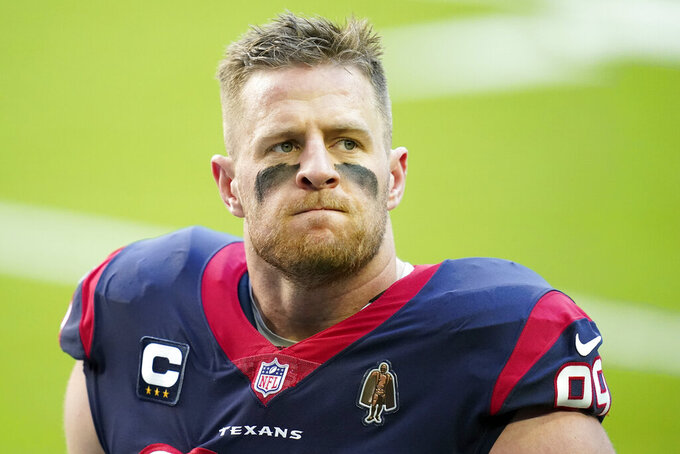 "FILE - In this Jan. 3, 2021, file photo, Houston Texans defensive end J.J. Watt (99) looks on before an NFL football game against the Tennessee Titans in Houston. Watt and the Texans have ""mutually agreed to part ways,"" ending the tenure of the face of the franchise and adding another huge change to an offseason filled with upheaval. (AP Photo/Matt Patterson, FIle)"