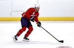 Florida Panthers center Sam Bennett skates with the puck during an NHL hockey training camp Thursday, Sept. 23, 2021, in Sunrise, Fla. (David Santiago/Miami Herald via AP)