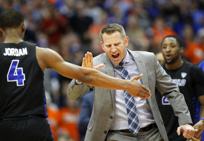 FILE - In this Tuesday, Dec. 18, 2018, file photo, Buffalo head coach Nate Oats celebrates with Buffalo's Davonta Jordan (4) late in the second half of an NCAA college basketball game against Syracuse in Syracuse, N.Y. Oats' fearless and unfiltered approach to basketball has Buffalo off to its best start in school history, and in position to secure their fourth NCAA Tournament berth in five years. (AP Photo/Nick Lisi, File)