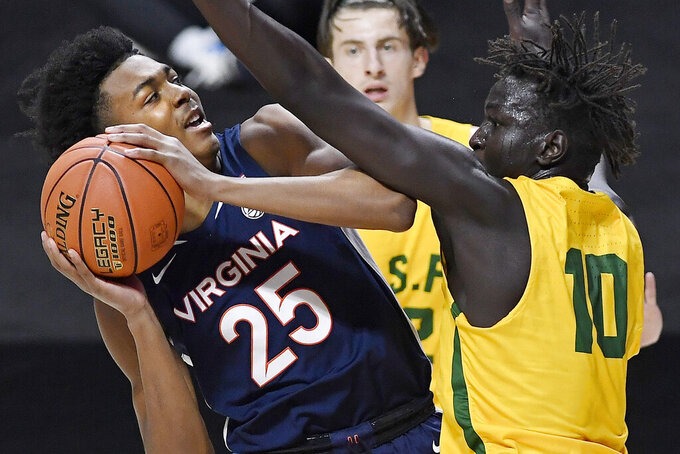 Virginia's Trey Murphy III, left, is fouled by San Francisco's Josh Kunen in the first half of an NCAA college basketball game, Friday, Nov. 27, 2020, in Uncasville, Conn. (AP Photo/Jessica Hill)