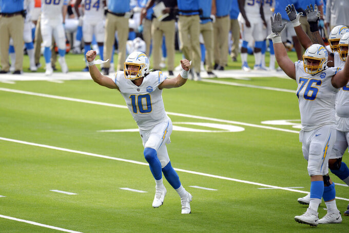 Los Angeles Chargers quarterback Justin Herbert celebrates after throwing his first career touchdown pass during the first half of an NFL football game against the Kansas City Chiefs Sunday, Sept. 20, 2020, in Inglewood, Calif. (AP Photo/Kyusung Gong)