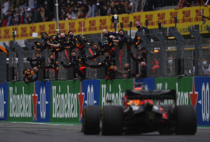 Third placed Red Bull driver Max Verstappen of the Netherlands crosses the finish line during the Formula One Portuguese Grand Prix at the Algarve International Circuit in Portimao, Portugal, Sunday, Oct. 25, 2020. (Rudy Carezzevoli, Pool via AP)