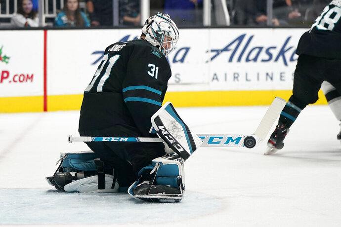 San Jose Sharks goaltender Martin Jones (31) blocks a shot on goal by the Los Angeles Kings during the second period of an NHL hockey game in San Jose, Calif., Friday, Nov. 29, 2019. (AP Photo/Tony Avelar)