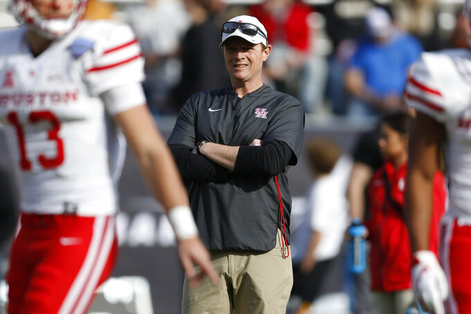 Houston head coach Major Applewhite watches as his team warms up before they play Army in the of Armed Forces Bowl NCAA college football game Saturday, Dec. 22, 2018, in Fort Worth, Texas. (AP Photo/Jim Cowsert)
