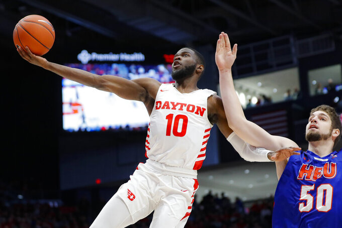 Dayton's Jalen Crutcher (10) shoots against Houston Baptist's Ryan Gomes (50) during the first half of an NCAA college basketball game, Tuesday, Dec. 3, 2019, in Dayton, Ohio. (AP Photo/John Minchillo)