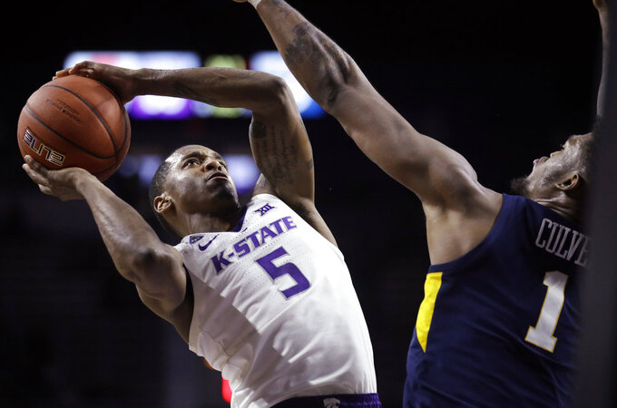 Kansas State guard Barry Brown Jr. (5) shoots over West Virginia forward Derek Culver (1) during the second half of an NCAA college basketball game in Manhattan, Kan., Wednesday, Jan. 9, 2019. (AP Photo/Orlin Wagner)